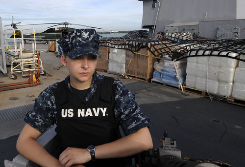 Sailor stands watch as USS Blue Ridge departs to support earthquake relief efforts.