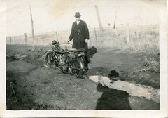 Bogged (1920s) (pellethepoet) Tags: shadow man hat fence snapshot australia motorbike photograph barbedwire motorcycle dirtroad barbedwirefence countryroad vintagemotorcycles