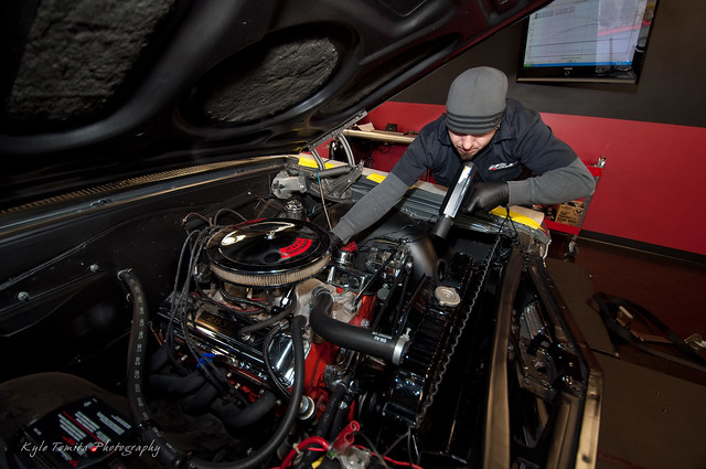 Russ adjusting the timing on a 65 Malibu SS