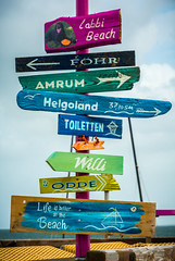 Colourful sings, Isle of Sylt, Germany (vonHabsburg) Tags: germany deutschland natur nature sea meer landschaft landscape sky himmel clouds wolken wasser water schilder schild sign signs bunt colourfull sylt insel isle