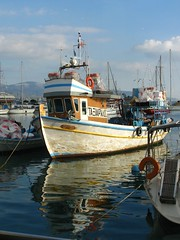 Fishing boat (Tilemahos Efthimiadis) Tags: sea reflection water boats boat wooden fishing colorful harbour hellas athens greece 100views fishingboat 50views mikrolimano faliro     piraues superhearts       address:city=athens address:country=greece
