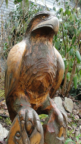 Wood carving of an Eagle with a salmon in its talons