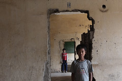 Tuol Sleng, S21, Phnom Penh - Depth Of Feel (Mio Cade) Tags: boy museum kid cambodia child sau cell prison doorway fujifilm kenai phnom penh s21 sleng tuol x100