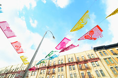 887 Pennants (JoelZimmer) Tags: nyc newyorkcity blue sky newyork colors brooklyn streetlight neon tokina mexican williamsburg overexposed ultrawide pennants d7000 nikod7000