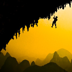 A climber in Yangshuo (samthe8th) Tags: sunset fall sam yangshuo diego fug anythinggoes moonhill d90 flickrchallengewinner herowinner ultraherowinner
