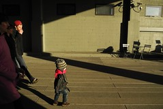 tiny motocycle jacket (omoo) Tags: newyorkcity railroad sunlight skyline toddler chelsea cityscape child manhattan elevated lightandshadow streetscenes highline citypark lateafternoonsun breezeway redscarf motorcyclejacket toddling inthelead elevatedcityparkthatfollowstheoldhighlinefreighttracks abandonedfreighttracks parkwalkwaygoesunderbuildings tinymotorcyclejacket