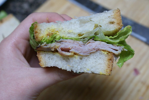 ciabatta with ham, lettuce, and mustard.