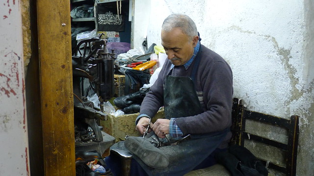 A Cobbler Repairs a Pair of Boots in the Old City of Jerusalem