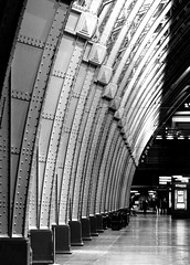 The arches of St Pancras (Rich007) Tags: uk greatbritain roof england blackandwhite bw london monochrome station night contrast train dark evening blackwhite europe arch cathedral eurostar unitedkingdom britain 19thcentury shed platform victorian rail arches trains terminal gb bandw canopy railways stpancras barlow chunnel supports nineteenthcentury channeltunnel 1868 saintpancras williamhenrybarlow stpancrasinternationalstation cathedraloftherailways
