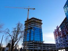 Blumau Tower (austrianpsycho) Tags: tower linz crane flags baustelle turm constructionsite kran buildingsite bauen gebude hochhaus fahnen baukran xxxlutz blumauerstrase blumautower
