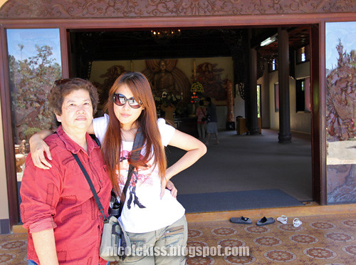 me and mom in front of temple