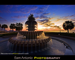 Having a Sweet Time at the Pineapple Fountain (Sam Antonio Photography) Tags: blue orange water fountain america sunrise river lowlight cityscape southcarolina wideangle explore mansion antebellum waterfrontpark travelphotography flickrexplore americansouth pineapplefountain waterfrontparkcharleston canoneos5dmkii samantonio southcarolinaphotography samantoniophotographycom pineapplecharleston canon1740f4lens