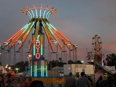 Yo Yo At Dusk. (dccradio) Tags: lumberton nc northcarolina robesoncounty robesonregionalagriculturalfair countyfair fair communityevent festival fun entertainment amusementrides amusements fairrides rides thrillrides carnivalrides mechanicalrides carnivalmidway carnival midway sunset dusk evening lights swings swingride carnivalswings skywheel doubleferriswheel chancerides yoyo