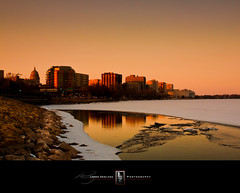 Sundown On Lake Monona (Loren Zemlicka) Tags: light sunset usa lake snow reflection ice water skyline wisconsin buildings photography gold evening march photo twilight rocks sundown image dusk shoreline picture capitol madison shore dome northamerica canonef1740mmf4lusm goldenhour monona isthmus 2011 johnnolendrive canoneos5d danecounty madison365 lorenzemlicka