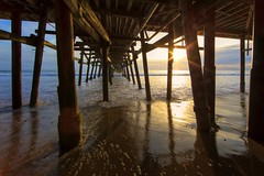 under the pier (Eric 5D Mark III) Tags: ocean california blue light sunset shadow sky usa cloud seascape reflection beach water contrast canon landscape pier vanishingpoint unitedstates horizon perspective wave wideangle structure orangecounty sanclemente ef14mmf28liiusm eos5dmarkii