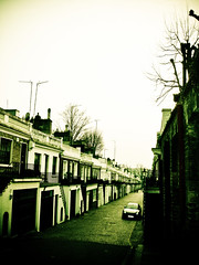 Holland Park Mews (KJGarbutt) Tags: road park street uk blue houses homes light england sky sun sunlight holland london car photoshop altered photography chelsea adobephotoshop britain path photoshopped sony capital cybershot adobe lane rays kensington kurtis cobbles tweaked mews pathway photoshopping hollandpark picassa garbutt hollandparkmews kjgarbutt kurtisgarbutt kurtisjgarbutt kjgarbuttphotography
