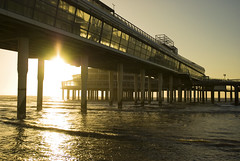 Sunset Pier Scheveningen (Marco Boekestijn) Tags: ocean sunset sea building beach water netherlands glass dutch architecture backlight vintage point photography pier nikon warm boulevard colours view bright scheveningen den noordzee delft marco below haag pillars tegenlicht d80 boekestijn