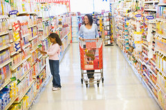 Mother and daughter shopping in supermarket (cabremixproject) Tags: food woman cute girl beautiful smiling shop horizontal retail female shopping mom happy thirties kid pretty child adult trolley budget daughter young mother lifestyle supermarket aisle mum american attractive africanamerican customer cart 7yearsold groceries shelves twopeople department 30s consumer ethnicity spending buying pushing