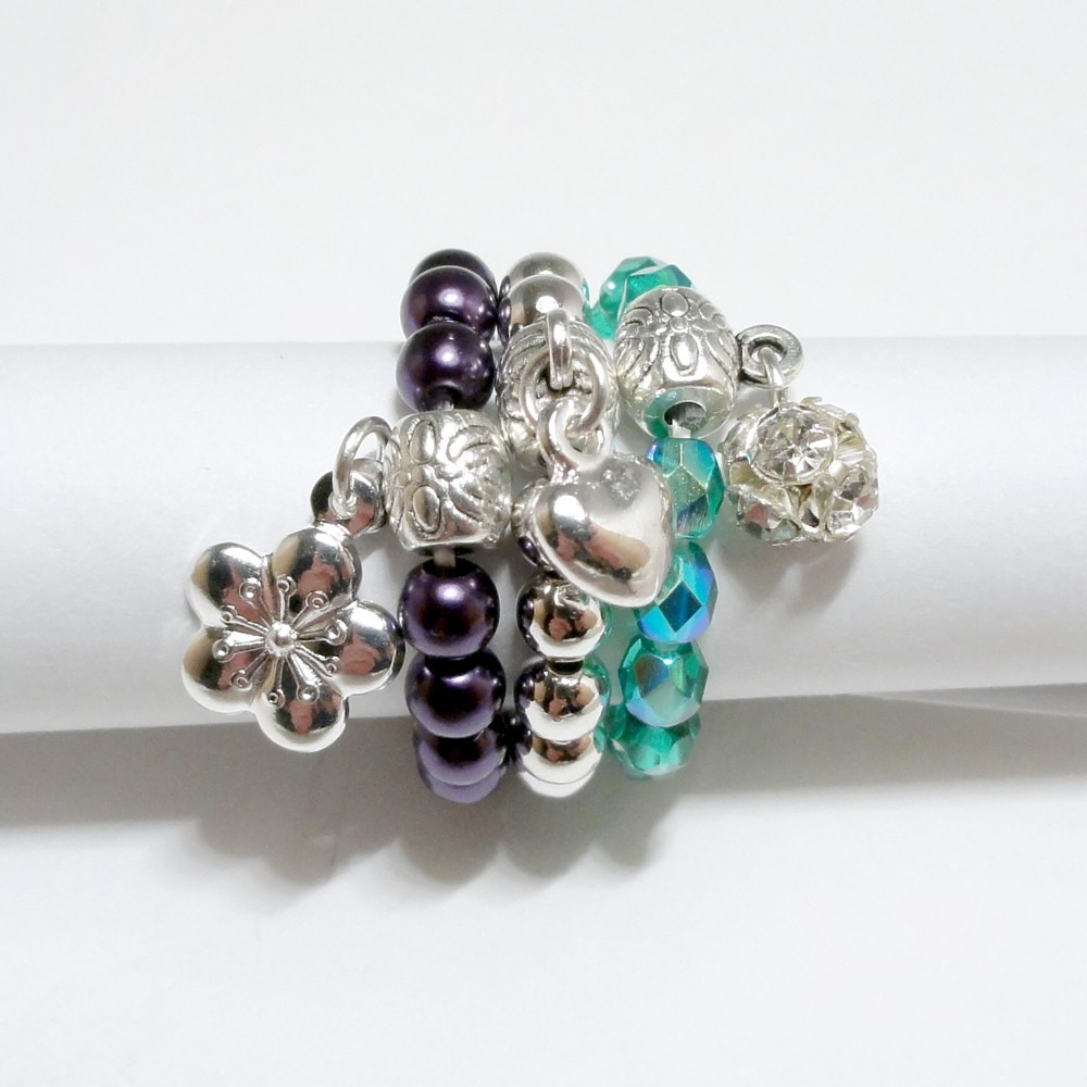 Three Stretchy Stackable Rings in Silver, Purple and Teal - Starlet