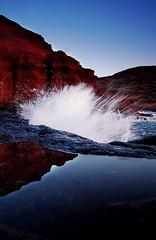 The gatecrasher (blinkingidiot) Tags: sunset reflection lanzarote redcliffs lastlight elgolfo lagunaverde greenlagoon