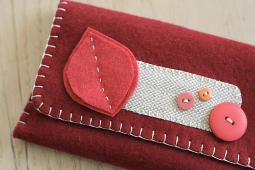 cranberry felt wallet.