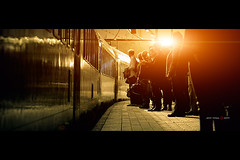 Queued (Jeff Krol) Tags: city morning sunset people sun train waiting utrecht pentax platform line queue trainstation flare cinematic waitinginline 135mm queued pentaxsmc smcpentax135mmf25 jeffkrol hoomark