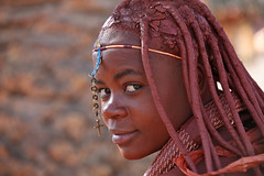 Himba girl (Ferdinand Reus) Tags: africa portrait people woman girl beautiful smile pretty cross african traditional religion young culture tribal christian safari afrika christianity tribe ethnic namibia fille tribo himba angola afrique ethnology tribu herero namibie bantu tribus ethnie himbas bantue