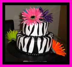 Zebra Cake w/Bright Flowers - back view (tinkabellz17) Tags: pink flowers blue orange white black green cake purple candy zebra gerberadaisies fondant buttercream zebrastripes sixlets sweetsbytink