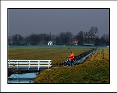 De mens en zijn......./  The man and his.... (Theo Kelderman) Tags: holland haarlem netherlands canon nederland brug schalkwijk fietser 2011 grasland weilanden manandhisenvironment theokeldermanphotography verenigdepolders mensenzijnomgeving