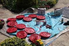 Sprucing up the stepping stones firstly with a red base coat (Four Seasons Garden) Tags: red marie stone garden four seasons picture tony ornament national scheme henri newton walsall ngs