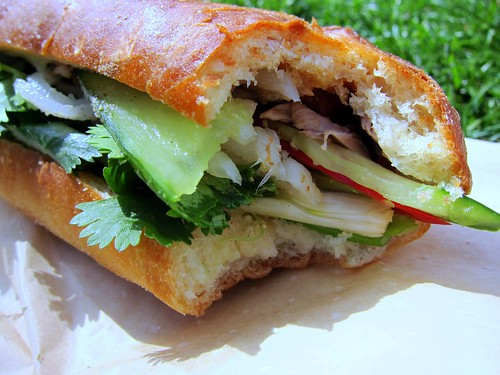 Spicy roast duck bánh mì with daikon and coriander