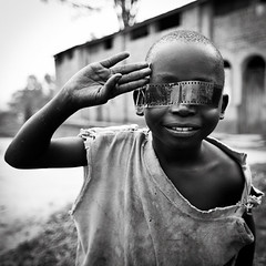 "Lendu ""Mad Max"" boy     - DR CONGO - (C.Stramba-Badiali) Tags: poverty africa boy portrait people blackandwhite film face contrast pose fun person child noiretblanc expression african human conflict blackpeople shavedhead ethnic enfant madmax humanbeing complicity drc visage regard swahili africain afrique zaire rdc drcongo blackchildren blackskin congolese centralafrica lingala gety ethnie musungu ituri ethnicgroup peaunoire afriquecentrale lendu canon5dmkii tterase forgottenconflict christophestrambabadiali ituridistrict ontheeyes"