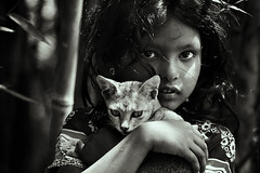 A Feline Affair [..Sunamganj, Bangladesh..] (Catch the dream) Tags: light bw pet love girl monochrome look animal rural cat blackwhite feline arms affection rustic cuddle intimate bangladesh cuddling bnw intimacy relation petcat q2 sunamganj catchthedream mohammadmoniruzzaman gettyimagesbangladeshq2 gettyimagesbangladesh