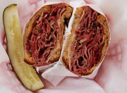 Reuben sandwich with pickle.