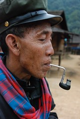 Man smoking surreal pipe (Noel Molony) Tags: family children rice health stories waterpumps healthcentre monvillage concernstaff educationonhealth hamkongvillage haumeuangdistrict pakhataivillage pasortvillage salongvillage salorvillage samhouay sopkhamvillage tarkaivillage thathvillage
