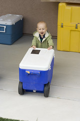 Logan loves pushing the coolers around