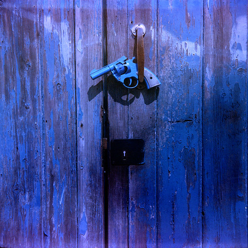 blue gun on a blue door by pho-Tony