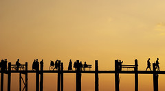 People crossing U Bein Bridge (Kokkai Ng) Tags: wood travel sunset people orange colour tourism bicycle silhouette horizontal walking outdoors photography cycling asia southeastasia crossing footbridge dusk manmade myanmar copyspace sparse clearsky crowded traditionalculture amarapura ubeinbridge villagelife traveldestinations ruralscene nonurbanscene unrecognisableperson mandalaydivision builtstructure numberofpeople traditionalorientalculture traditionallymyanmarian lphectic