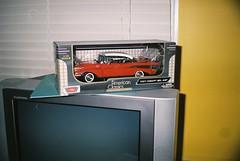 Model car (1957 Chevrolet Bel Air) in box, on top of CRT (LG Flatron) TV set (Matthew Paul Argall) Tags: elikon35c elicon35c fujicolor100 fujifilm 100speedfilm 100isofilm vignetting blinds tv television modelcar chevrolet toy unlimitedphotos belomo
