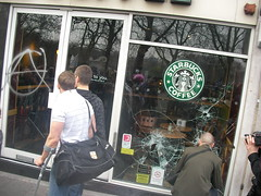 Starbucks windows smashed with anarchy A grafitti