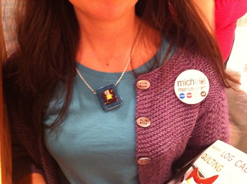 Michelle at Powell's wearing a log cabin block necklace!
