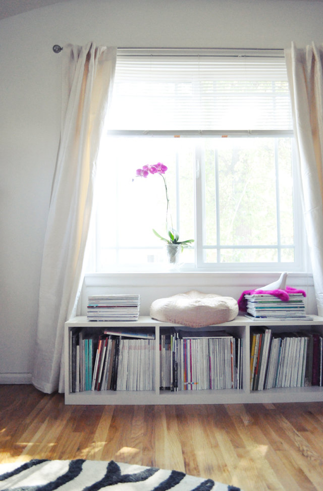 white silk curtains + purple orchid + window