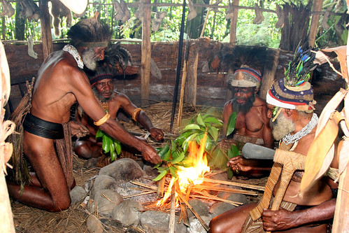 Melpa men of the Tokua village near Mt Hagen, Papua New Guinea perform a moka where they exchange gifts and confer on village matters.