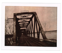 POLAROIDiZMPrince of Wales Railway Bridge (f1design) Tags: railroad trestle bridge abandoned film analog vintage polaroid graffiti decay urbandecay traintracks railway ishootfilm expired ottawariver notrespassing expiredfilm usufruct polaroidpropack graffitied type100 ottawaontario trestlebridge polaroidfilm ottawaon f1design chocolatefilm princeofwalesbridge markusholmes chocolatecolour peelbackfilm propackcamera polaroidpropackcamera type100film impossibleproject polaroidtype100film impossiblefilm impossiblechocolate