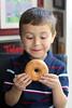 Mmmm... Donuts (Sam Howzit) Tags: eating donuts athan april30 2011 dayofthedonut