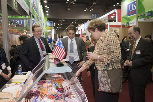 Ambassador Kathleen Stephens examines the wide range of cheeses being exhibited at Seoul Food and Hotel show with  Don Day-Gomes and Blair Tritt, International Sales Managers, for Schreiber Foods, Inc. of Green Bay, Wisconsin.