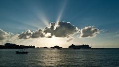 Sunrays (supra455) Tags: blue sky yellow clouds mexico boat ships caribbean sunray yucatanpeninsula