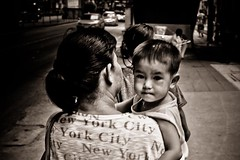 De New York City a Bangkok...Mre et son enfant  dans les rues de Bangkok. (Didier Jacquier) Tags: family portrait people blackandwhite child noiretblanc mother enfant regard thailande mre