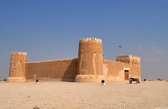 Al Zubara Fort. :] (renzeescoto :]) Tags: blue sky black smile photography al amazing sand gate niceshot desert fort canyon historical far doha qatar 2010 zubara 2011 dohaqatar brownred qatarflag alzubarafort renzeescoto renzeescoto|photography ralfflorenzevescoto