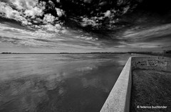 Portage Diversion (/ shadows and light) Tags: sky bw water monochrome wall clouds graffiti flood manitoba channel portagelaprairie